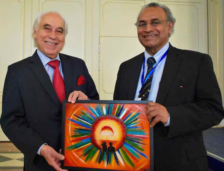 Photo: Sergio Duarte, incoming President of Pugwash, and his predecessor Jayantha Dhanapala who headed the organisation for ten years, with a painting by Kazakh artist and anti-nuclear activist Karipbek Kuyukov in Astana end of August 2017. Credit: Pugwash