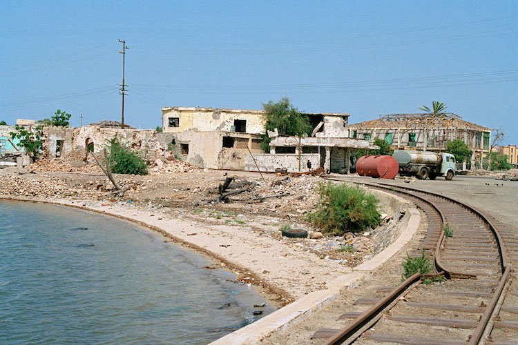 Photo: Bullet-riddled buildings and broken railway tracks testify to the heavy fighting seen by Massawa during Eritrea's struggle from independence from Ethiopia in 1990. Credit: UN Photo/Milton Grant.