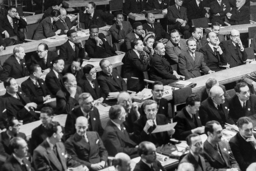 A view of the delegations gathered for the first session of the UN General Assembly when it opened on 10 January 1946 at Central Hall in London, United Kingdom. UN Photo/Marcel Bolomey