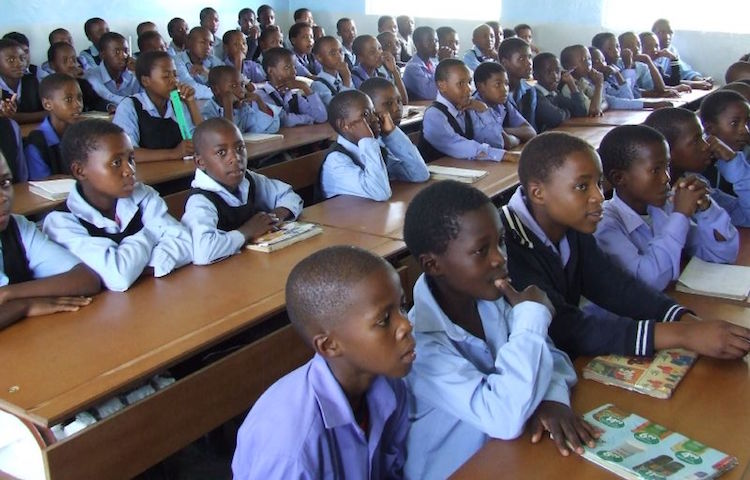 Photo: Uniformed children in class in Ha Nqabeni primary school, Lesotho. Credit: Wikimedia Commons.