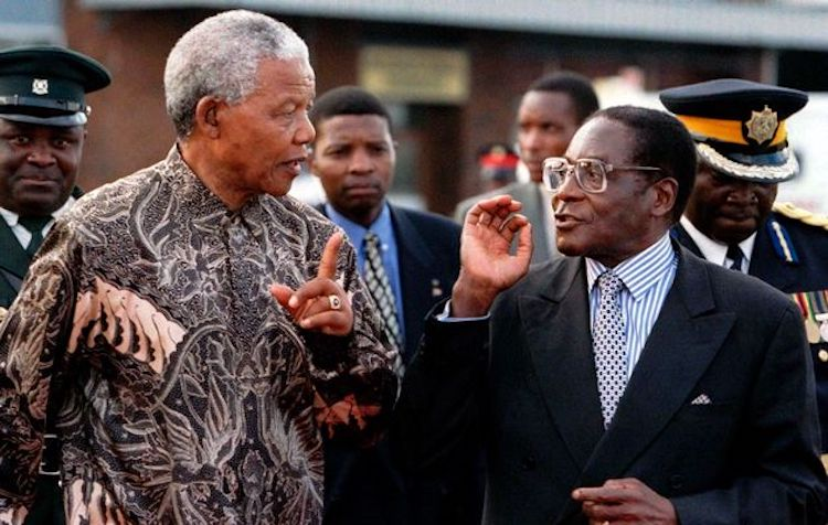 Photo: The late former South African President Nelson Mandela and President Robert Mugabe. Credit: The Herald