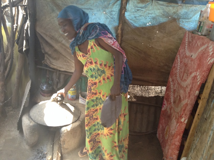 Photo: Najma Hassan cooking in her kitchen in Kakuma refugee camp, Kenya, Credit: Justus Wanzala | IDN-INPS