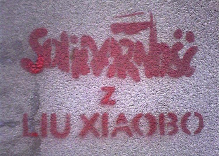 "Image: Polish mural in Warsaw, reading ""Solidarity with Liu Xiaobo"". Credit: Wikimedia Commons."