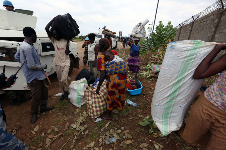 Photo: IDP's that took refuge and protection with UNMISS, pack up their belongings following five straight days of heavy clashes in Juba in early July. Photo: UNMISS/Eric Kanalstein