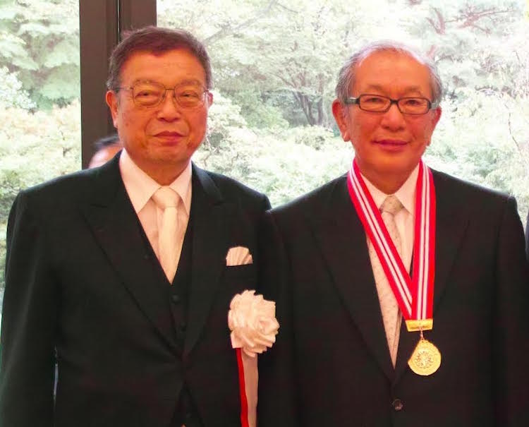Photo: DEVNET Japan President Akegawa (left) and former JICA Vice President Hideaki Domichi (right), recipient of a prestigious award. Credit: Devnet Japan