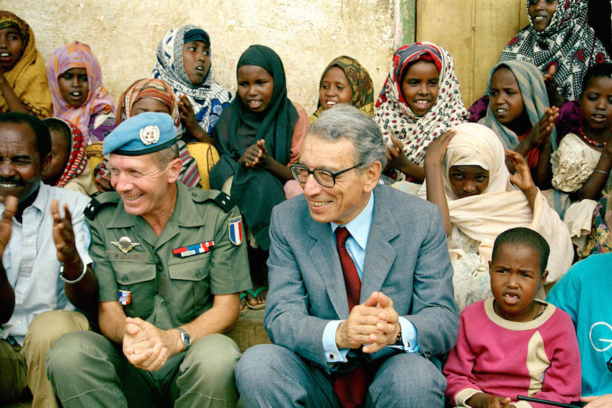 On a visit to Somalia in October 1993, Boutros-Ghali visits with young residents of a UN-supported orphanage in Baidoa, accompanied by Brigadier General Maurice Quadri, Commander of the French contingent of the Second UN Mission in Somalia. UN Photo/Fabrice Ribère