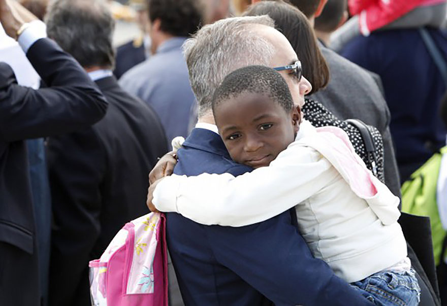 Congolese child with adopted relative in Rome
