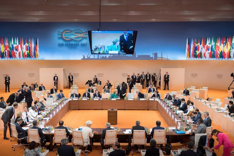 Photo: View of the conference room before the start of the third working meeting of the G20 summit on the Africa Partnership, migration and health. Credit: Bundesregierung | Bergmann.