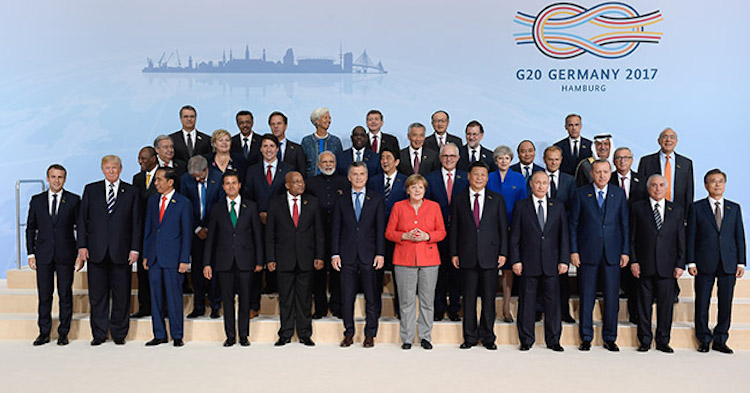 Photo: The G20 summit kicked off with the traditional family photo. Credit: Bundesregierung/Güngör
