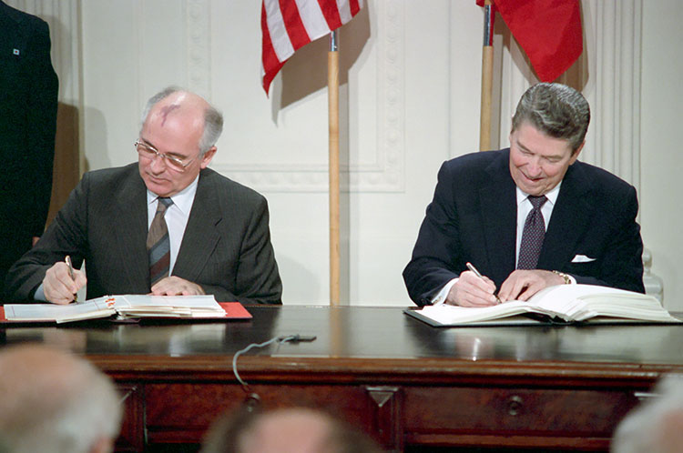 Photo: U.S. President Ronald Reagan and Soviet General Secretary Mikhail Gorbachev sign the Intermediate-Range Nuclear Forces Treaty in the East Room of the White House on December 8, 1987. Credit: Ronald Reagan Presidential Library.