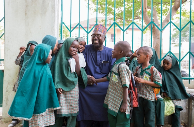 Photo: Mustapha and the students of Future Prowess Islamic Foundation School before morning assembly.  © UNHCR/Rahima Gambo