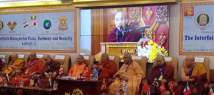 Photo: Final session of SAMVAD meeting with Yogi Adinath (fourth from left) seated among Buddhist and Hindu priests. Credit: Kalinga Seneviratne | IDN-INPS