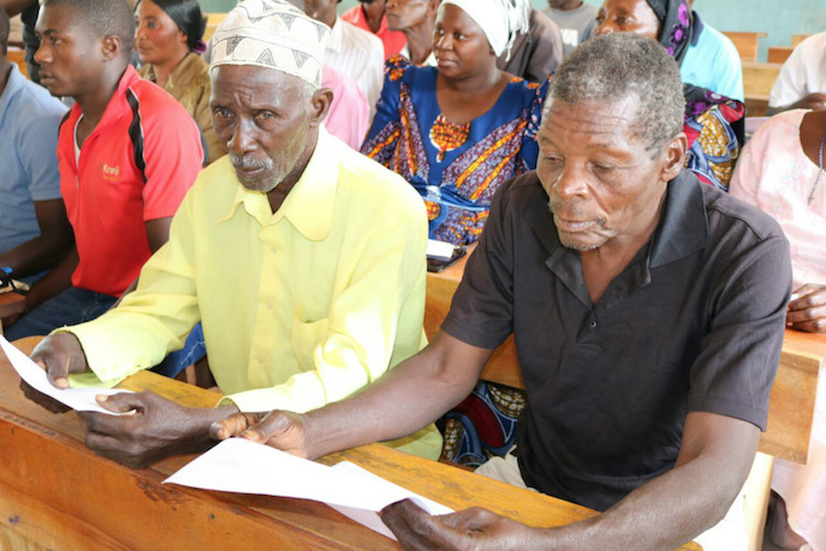 Photo: Residents of Vilabwa village attending a meeting, though men are still in the front row. Credit: Kizito Makoye